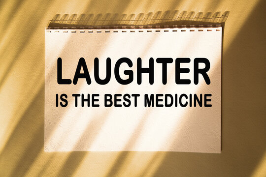 LAUGHTER IS THE BEST MEDICINE. Saying. expression written on a notepad. success