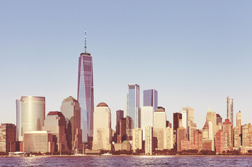 Manhattan business district panorama at sunset, color toned picture, New York City, USA.