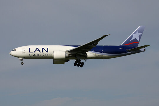 SCHIPHOL, THE NETHERLANDS - AUGUST 25, 2011: Chilean LAN Cargo Boeing 777F with registration N774LA on final for Amsterdam Airport Schiphol.