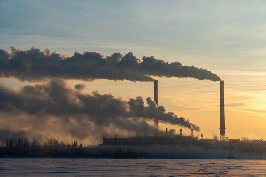 Plant pipes pollute atmosphere. Industrial factory air pollution, smokestack exhaust gases, thick smoke plumes. Climate change, ecology and global warming