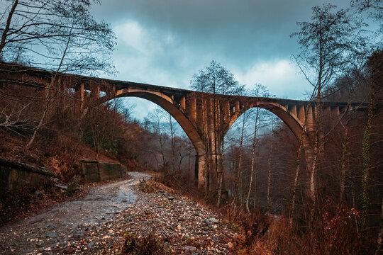 Old ruined abandoned railway bridge in Abkhazia