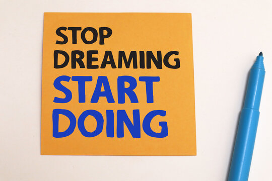 Stop dreaming start doing, text words typography written on paper, life and business motivational inspirational