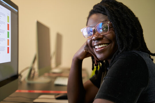 Black woman college student studying in computer lab