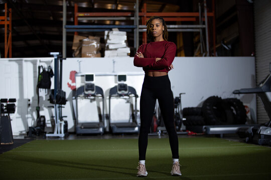 Young Black female athlete in gym