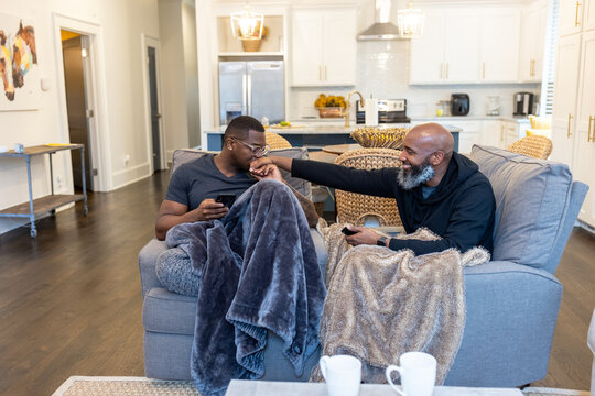 Lovely Black gay couple cozy at home, love connections