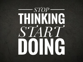 Selective focus.Word STOP THINKING START DOING on black background.Motivation concept.