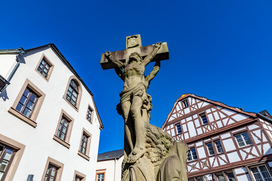 Half-timbered houses in Bernkastel-Kues, Germany with jesus statue