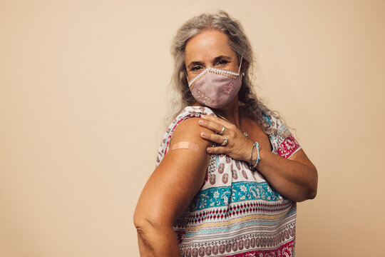 Woman showing her arm after getting vaccine