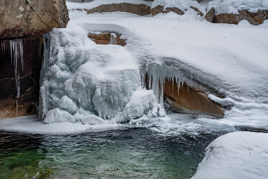 The Basin in Franconia Notch State Park during winter . New Hampshire mountains. USA