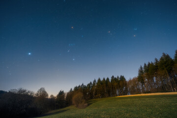 Fototapeta The Orion Constellation over the Odenwald near Lampenhain in Germany.