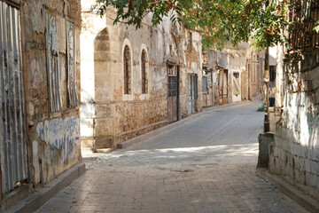 Narrow street with an ancient buildings. View of narrow alley with beautiful old architecture. Antalya, Turkey.