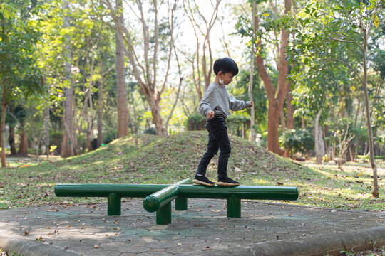 Asian boy playing and having fun with balance exercise