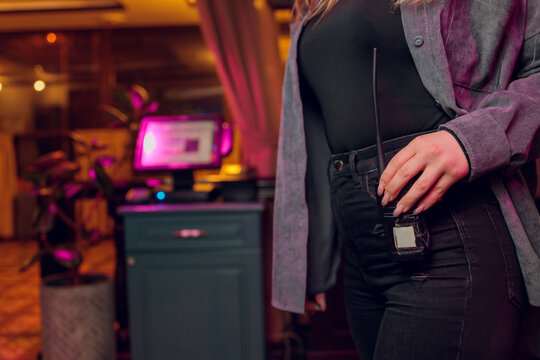 Close-up of female with Walkie talkie keeps on jeans.