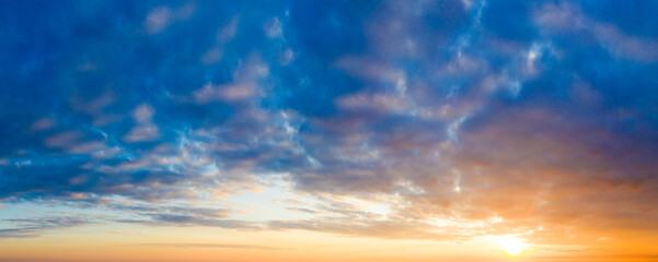 Natural background of the colorful panorama sky. Beautiful cloud in the sunrise sky background. Sky banners background.