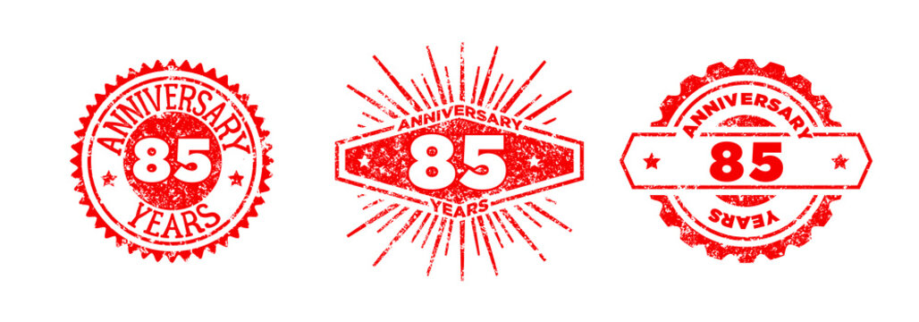 A group of 85 years anniversary logos drawn in the form of stamps, red frames for celebration. Grunge rubber stamp texture. Distressed texture stamp. Collection of postage stamps. Vector round stamps