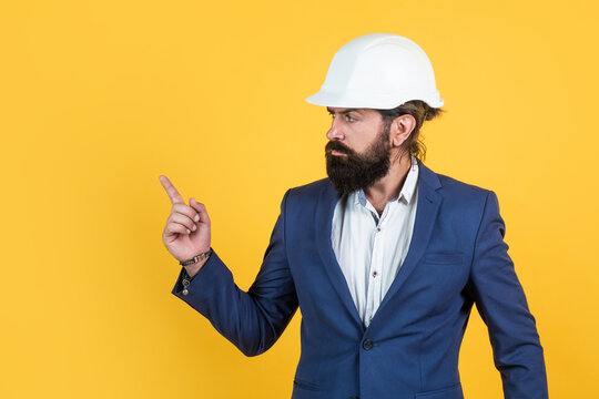 mature bearded man or businessman in costume and helmet, architechture