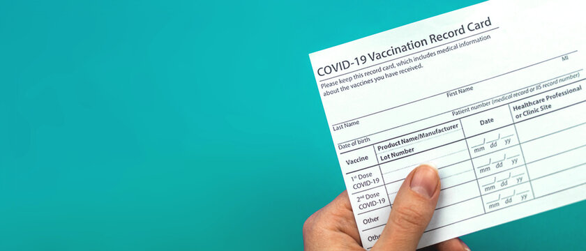 Doctor is holding COVID-19 vaccination record card, banner, concept of healthcare, copy space