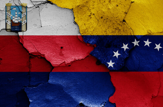 flags of Maracaibo and Venezuela painted on cracked wall