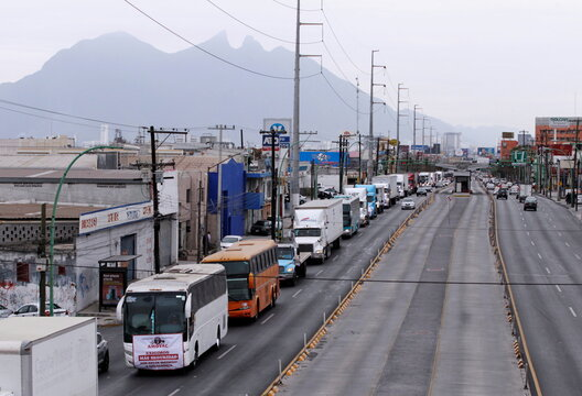 Trailer trucks take part in a caravan to protest against the Yaqui indigenous roadblocks in the state of Sonora, that are affecting the trade with the U.S. according to local media, in Monterrey