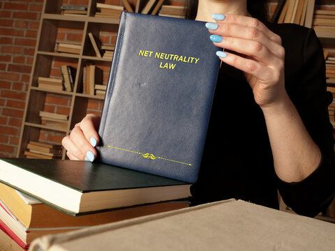 NET NEUTRALITY LAW book in the hands of a jurist. Net neutralityis the concept that all data traffic on a network should be treated indiscriminately