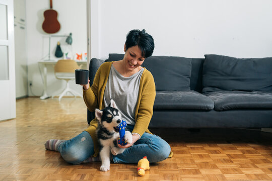 woman enjoying time with her puppy
