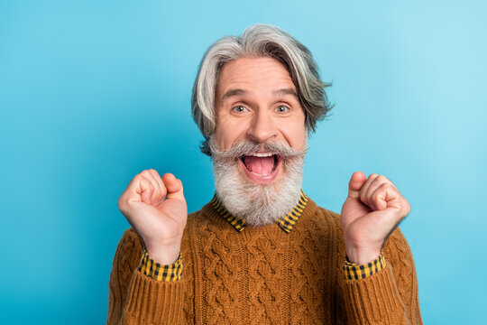 Photo portrait of overjoyed bearded man cheerful happy won lottery laughing isolated bright blue color background