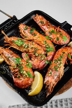 Grilled large shrimps with lemon and spices on the grill pan