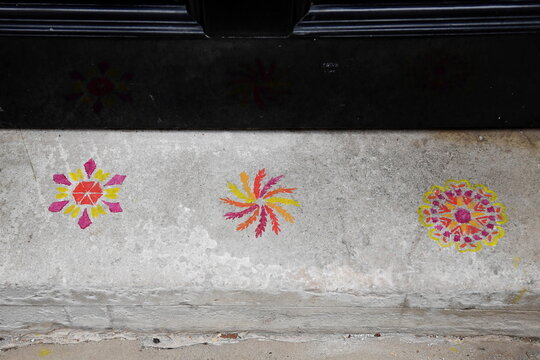 Patterns are seen on the doorstep of 11 Downing Street in London