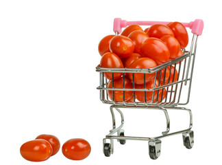 rolley with red tomatoes isolated on white background. Close-up of metal shopping cart on wheels for food.