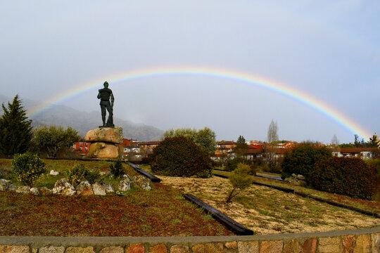 Arcoiris in Manzanares El Real. A complete rainbow in the Sierra de Guadarrama, in the town of Manzanares El Real, Community of Madrid, Spain