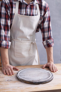 Baker man and pizza board and bakery ingredients for bread cooking on shelf