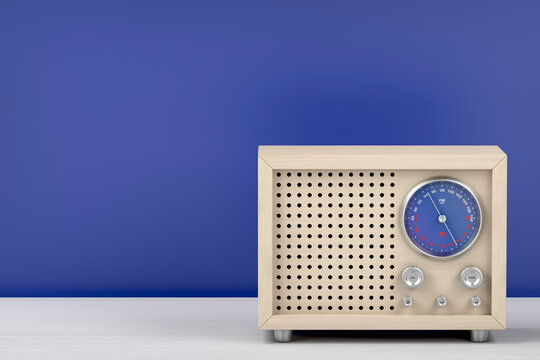 Wood radio in retro style on table, front view