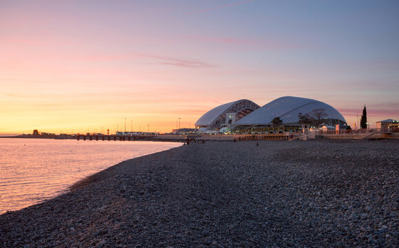 Russia, Sochi - March 04, 2019. Pebble beach and the Fisht Olympic stadium at sunset in Sochi, Adler.