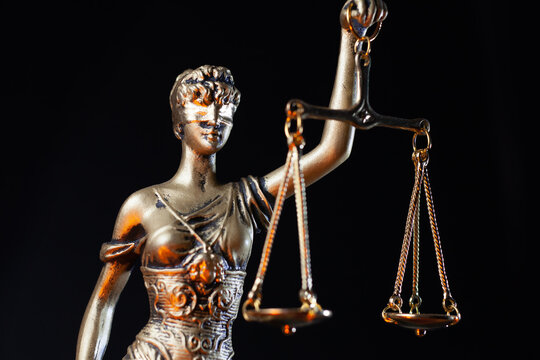 lady justice statue isolated on dark background