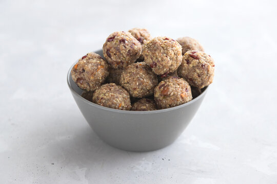 Homemade energy balls made from dried fruits and oatmeal. Healthy food, snack. Vegetarian, vegan raw dessert. Energy balls in a bowl on a gray background. close-up