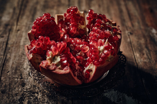 Ripe pomegranate on wooden table