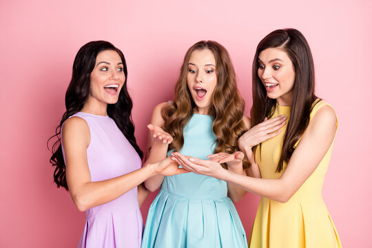 Photo of impressed nice long hairdo three ladies show ring wear pastel cloth isolated on pink color background
