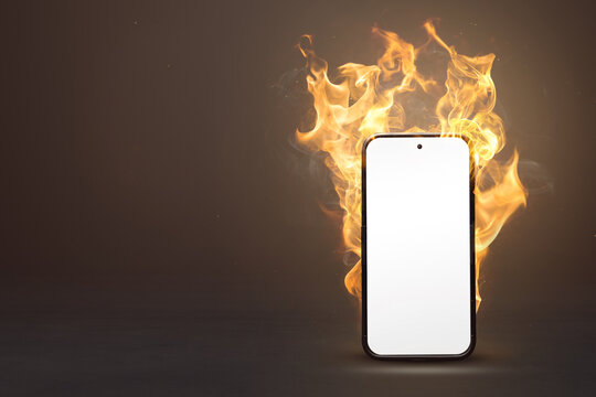 Blank smartphone on fire with copy space