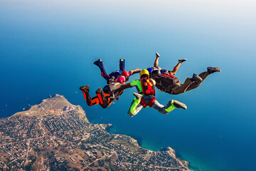 Skydiving group over the sea