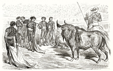 Matador pointing sword to bull during a bullfighting in a spanish arena. Ancient grey tone etching style art by Dore, Magasin Pittoresque, 1838