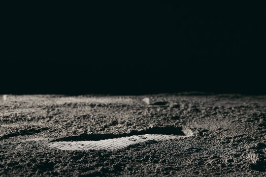 Footprint on the moon against a black background