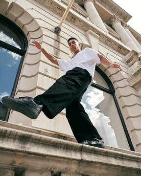 Man jumping on a wall