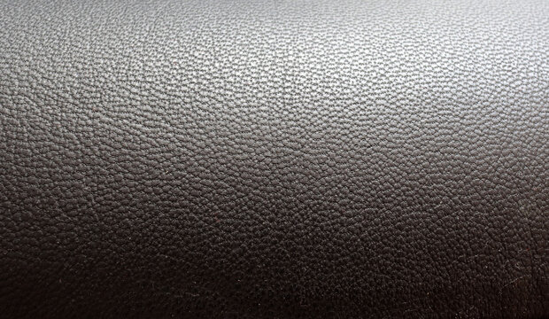 Surface of the leatherette black color for textured background. Top view. close up. decorative background