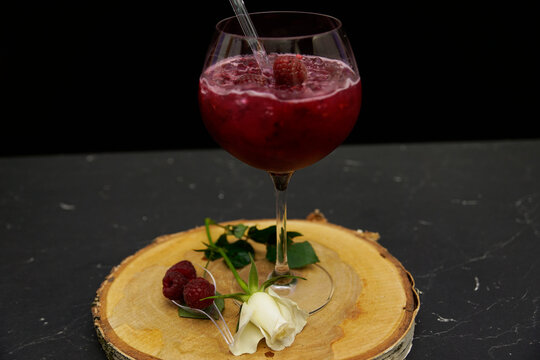 Raspberry gin cocktail in glass