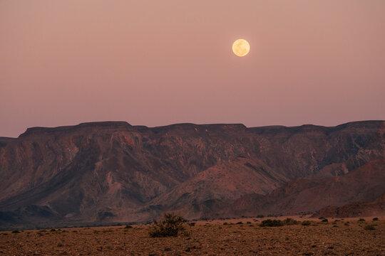full moon above ridge