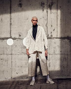 male fashion model posing in a concrete city carpark