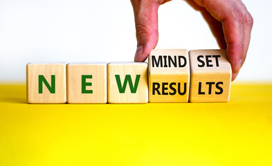 New mindset and results symbol. Businessman turns wooden cubes and changes words 'new mindset' to 'new results'. Beautiful white background. Business, new mindset and results concept. Copy space.
