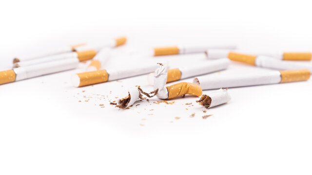 broken cigarettes on white background,harm of smoking