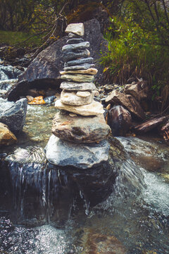Cairn on a river in Vanoise national Park valley, French alps