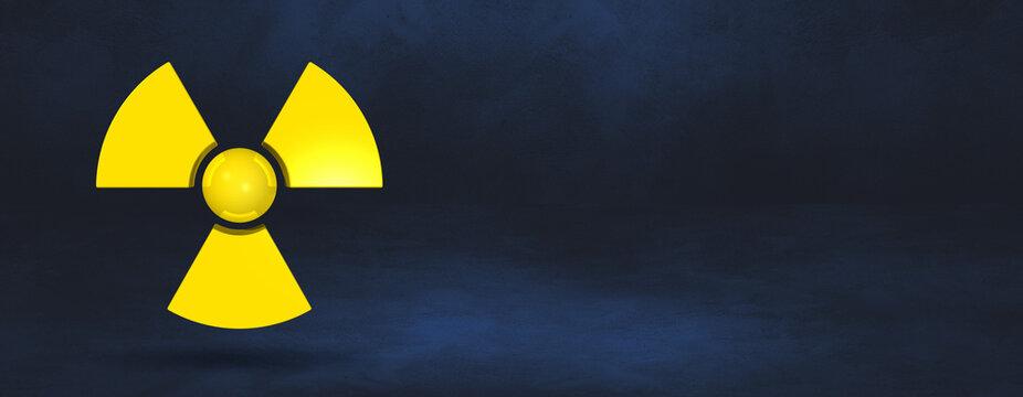 Radioactive symbol on a dark blue studio background banner
